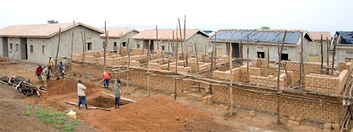 Row by row new homes are being built for genocide survivors by TIG prisoners.  Rwanda
