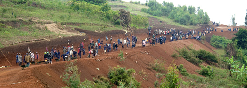 This new road is being excavated and leveled by TIG members. It leads to an area where other participants are constructing homes for genocide survivors. Rwanda