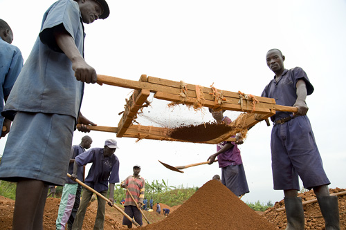 When the dirt is ready, it's carried to the brick making area.