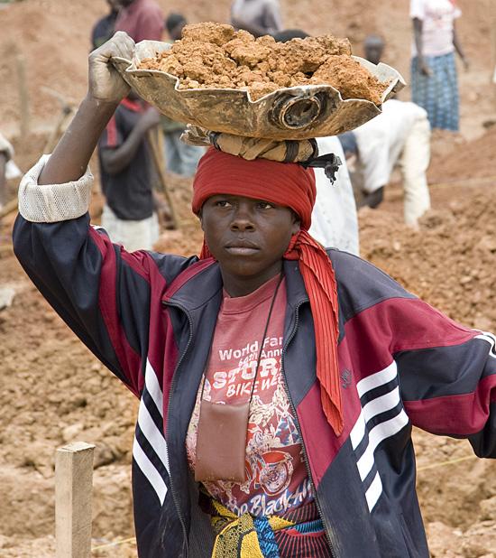 Woman hauling dirt from construction site, Butaro hospital, Rwanda