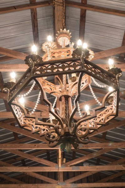 Barn chandelier gives a rustic yet elegant look for your special event