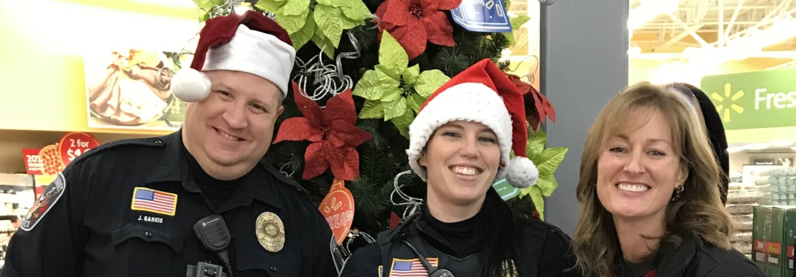 ENM Police Officers Spread Holiday Cheer with Shop with a Cop