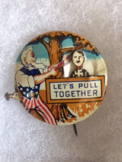 WW II Uncle Sam hanging Hitler pin