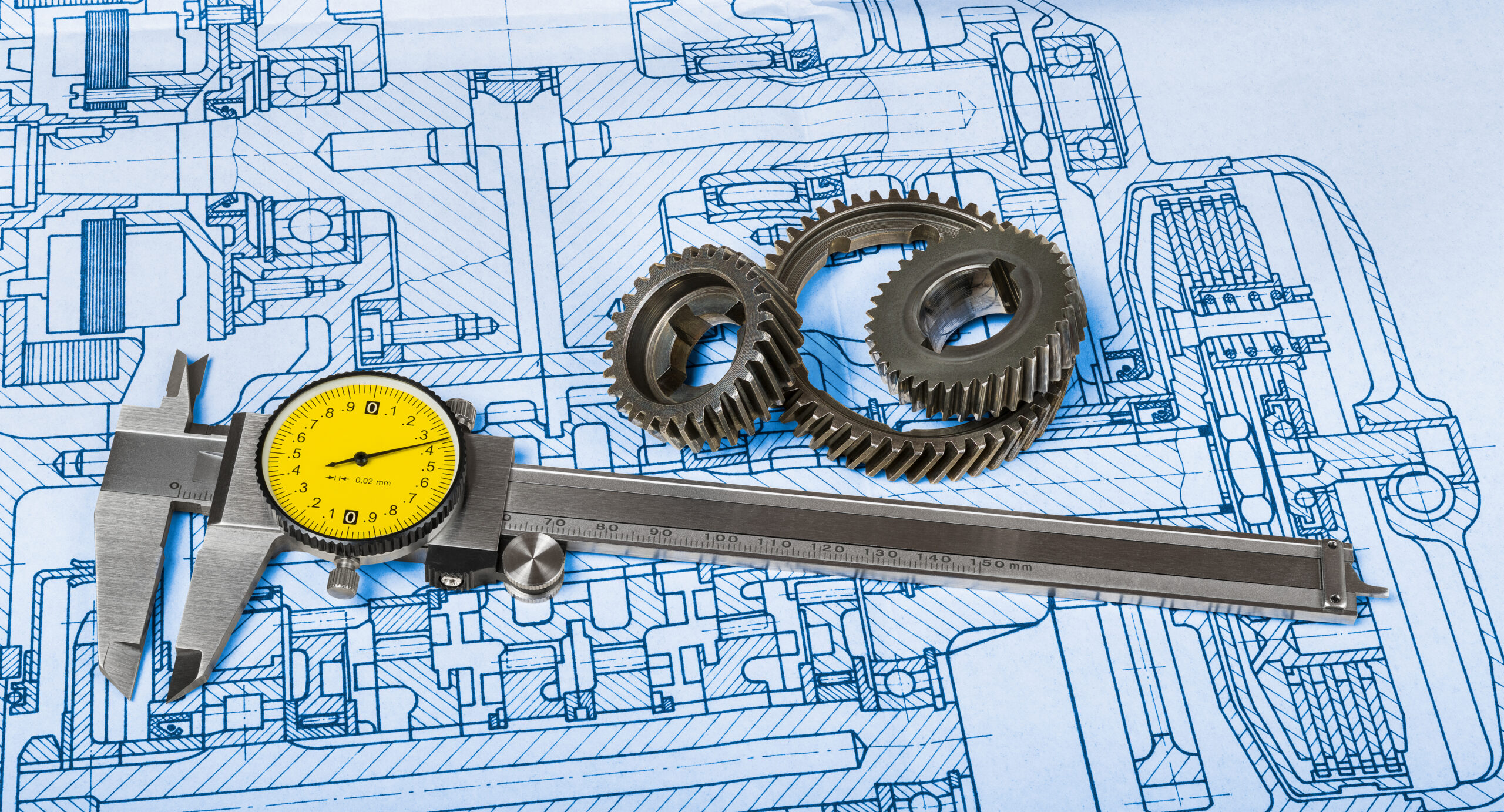 Sliding measuring tool. Round yellow dial. Steel gear wheels. Cogged metal parts on old professional documentation. Hatched plan. Engineering