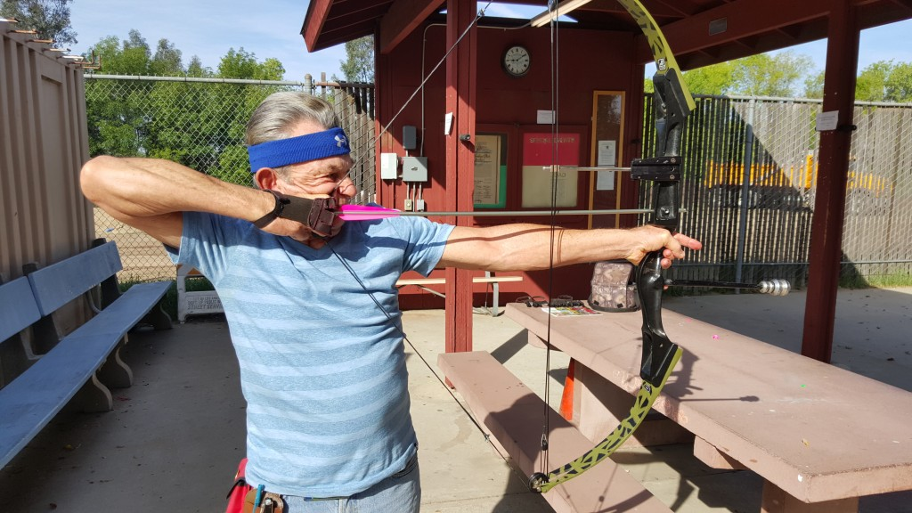 Cal Vogt, at the Woodley Park Archery Range, shows his shooting form. (Photo Credit: Andrew Robertson, 2016)