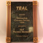 TEAL Electronics' Award for Outstanding Customer Service to L&T Precision 1996