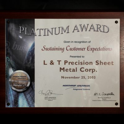 Northrop Grumman's Platinum Award for Sustaining Customer Expectations to L&T Precision 2003