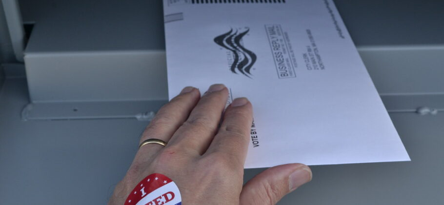 Man Placing Vote By Mail Ballot In Drop Box