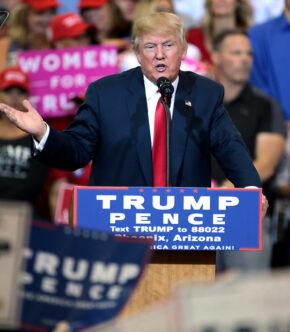 Donald Trump Standing At Podium At Trump Rally