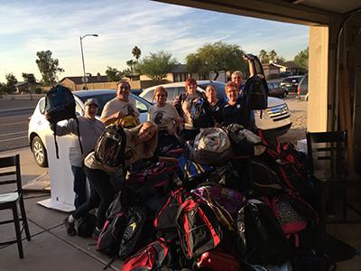 stuffed backpacks-homeless engagement lift partnership