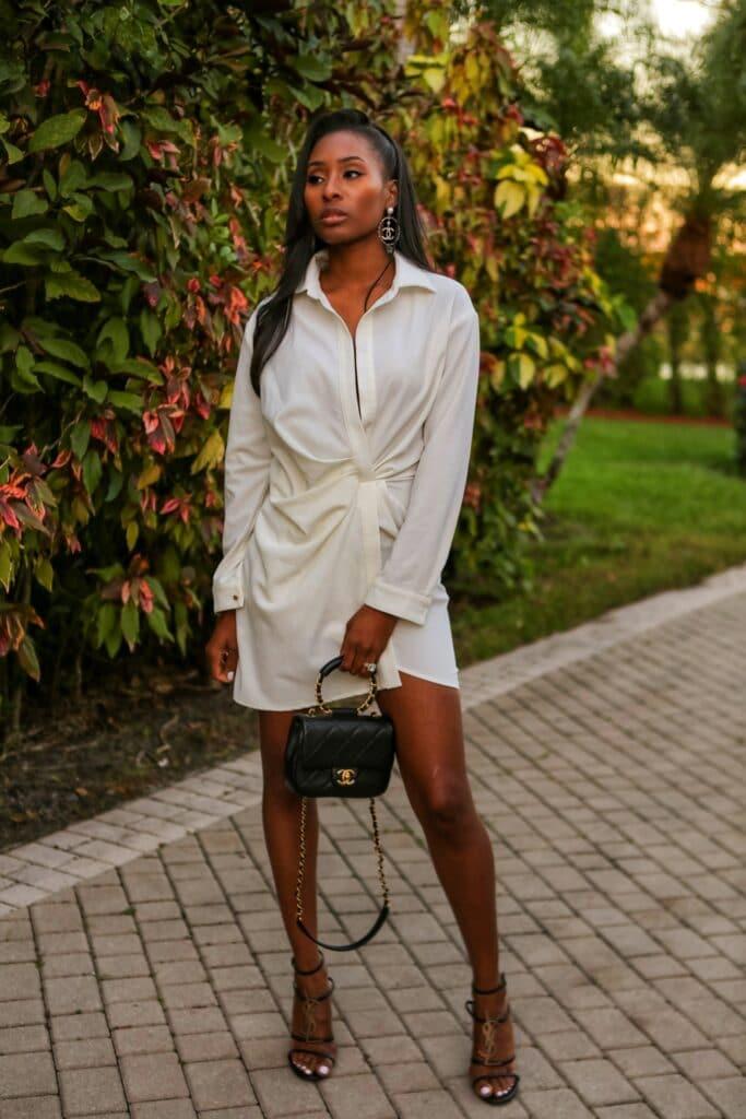 white asymmetrical dress with chanel mini bag