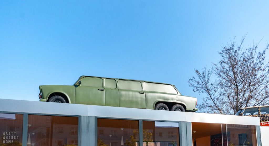 You can spot the entrance to Trabi Safari by the number of cars including the military-edition limousine on the roof.