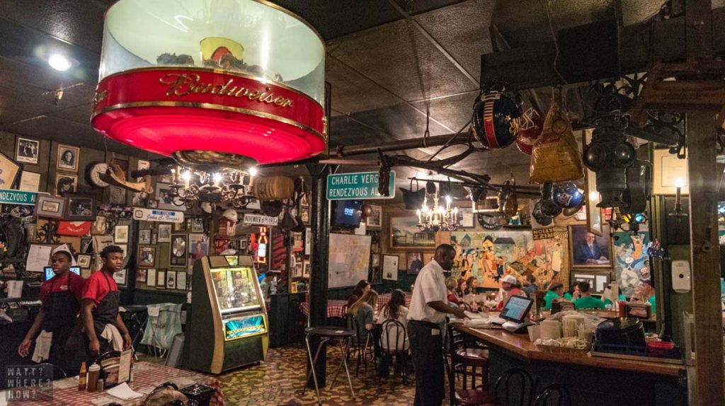 Inside Charles Vergos Rendezvous BBQ, it's like stepping back 50 years with its kitschy ephemera and old advertising signs.