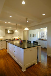 White cabinets and hardwood floors