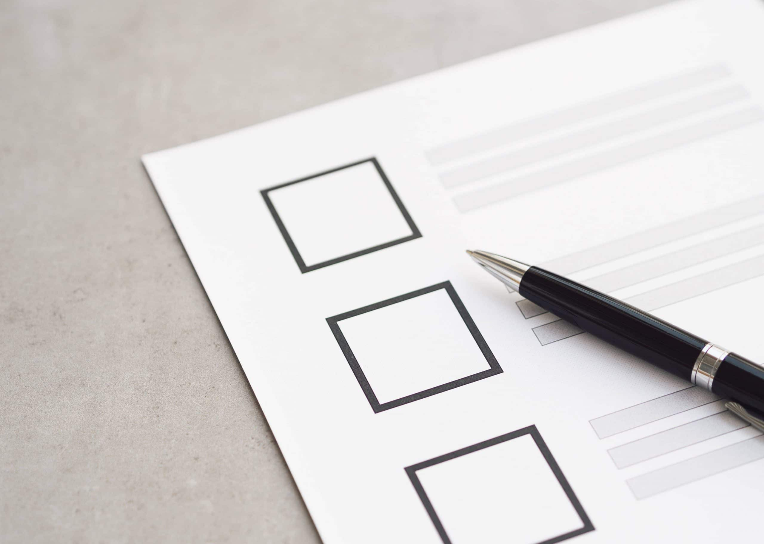 close-up-uncompleted-election-questionnaire-with-black-pen-min