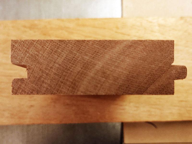 Flooring profile nail groove