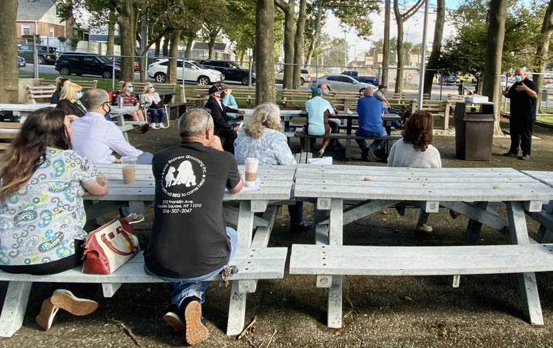 people sitting on picnic benches