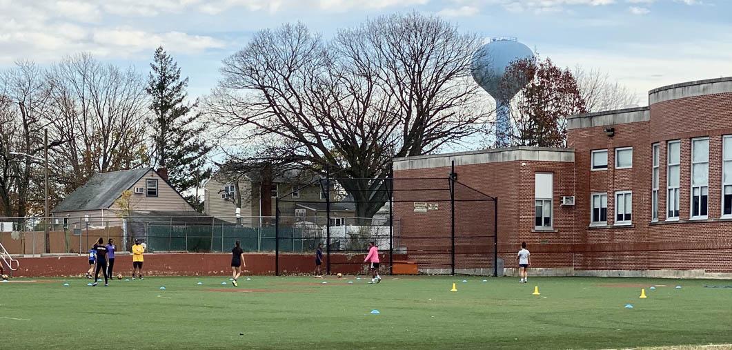 kids playing on school field