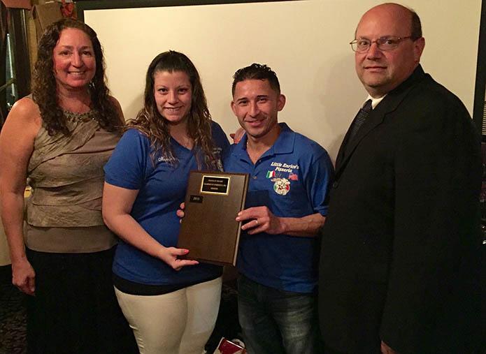 Little Enricos accepting an award