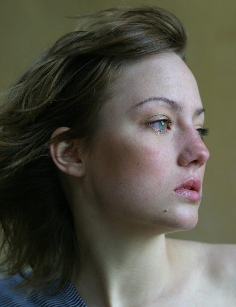 Woman looking left grieving loss of narcissistic relationship