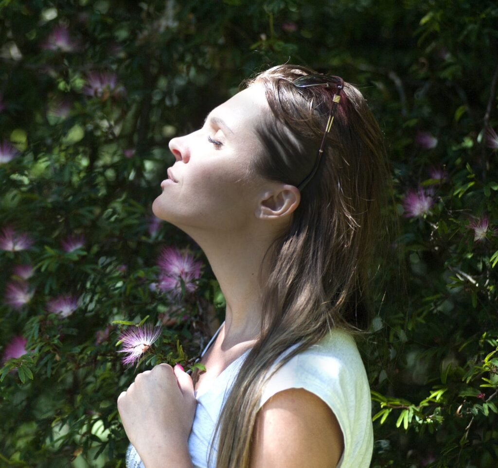 Woman with closed eyes practicing forgiveness