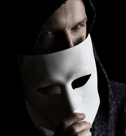 male malignant narcissist with mask