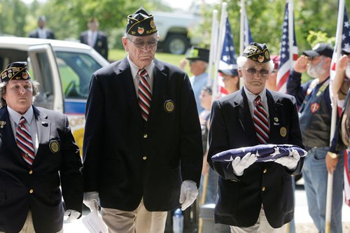 100526- Canton - L to R, Betty Herring, Guy Webb, and Darlene Money present the cremated remains of Ernest Carter, Jr., and an American Flag for the service.  Herring is assistant coordinator and Webb is coordinator of the Department of Georgia American Legion Missing in America Project.   Lonnie Brown, Jr., and Ernest Carter, Jr., two cremated veterans whose remains were unclaimed by family, were buried at the national veterans cemetery in Cherokee County today with a military funeral.  They died in Georgia. The remains were found at a funeral home that went bankrupt.  A state chapter of the Missing in American Project, which finds and buries unclaimed vets, discovered the remains and put the wheels in motion to get them buried.  Thurs,  May 27, 2010  Bob Andres bandres@ajc.com