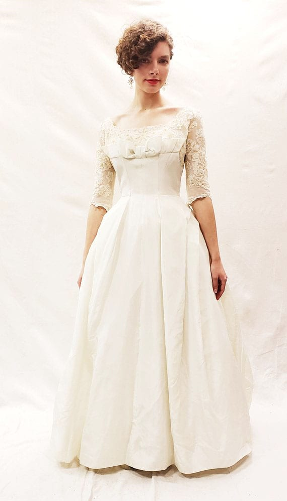 Backyard weddings are one of 10 current Pinterest trends that slant toward a truly inspiring ambition - being more green! Backyard weddings tend to have less of an environmental impact and also involve eco-friendly options like nature-inspired decor and vintage clothing - like this gorgeous 1950s wedding dress!