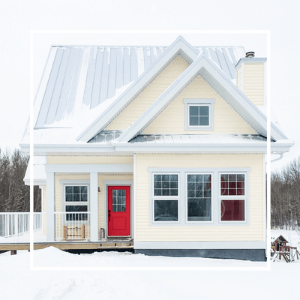 Yellow house with a red door in winter. Click here to visit the Our House in the Trees page.