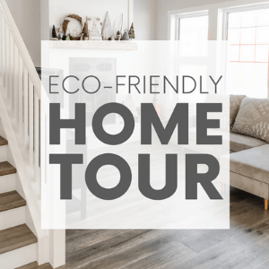 """Living room with wood floors, a fireplace and a grey couch with the words """"eco-friendly home tour."""" Click to visit post."""