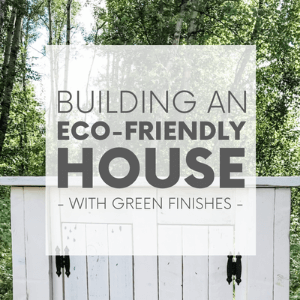 """A white wooden vanity in front of a green forest with the words """"building an eco-friendly house - with green finishes."""" Click to visit post."""