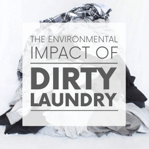 """A pile of white, black and grey laundry with the words """"the environmental impact of dirty laundry."""" Click to visit post."""