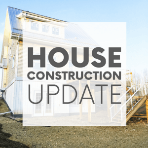 """A yellow house with a silver roof surrounded by dirt with the words """"house construction update."""" Click to visit post."""