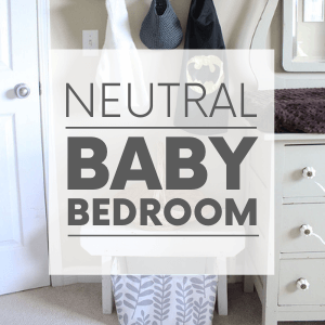 """A bedroom with a green dresser, a leaf basket and a superhero cape hanging on a hook with the words """"neutral baby bedroom."""" Click to visit post."""