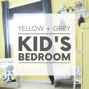 """A kid's bedroom with yellow walls, grey curtains and a floral bedspread with the words """"yellow + grey kid's bedroom."""" Click to visit post."""