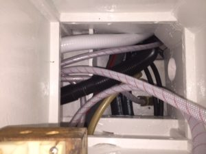 Another access point to plumbing in the galley