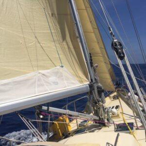 Puffin with her original sails but new Selden rig UK-bound