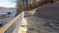 Custom handrails on seawall