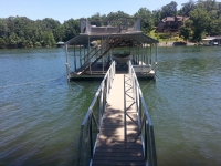 Single slip dock with sundeck and side gables