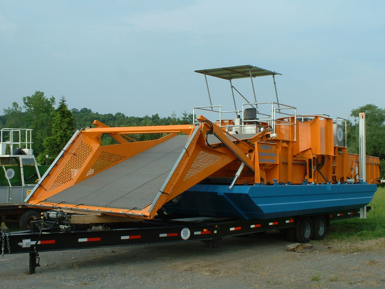 Alphaboats FX-11 Waterweed Harvester on an Alphaboats Transport Trailer