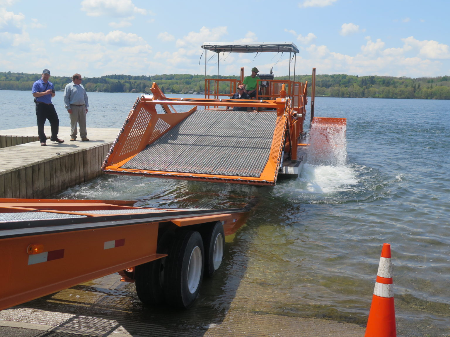 Alphaboats FX-11 Waterweed Harvester being Launched from a Transport Trailer