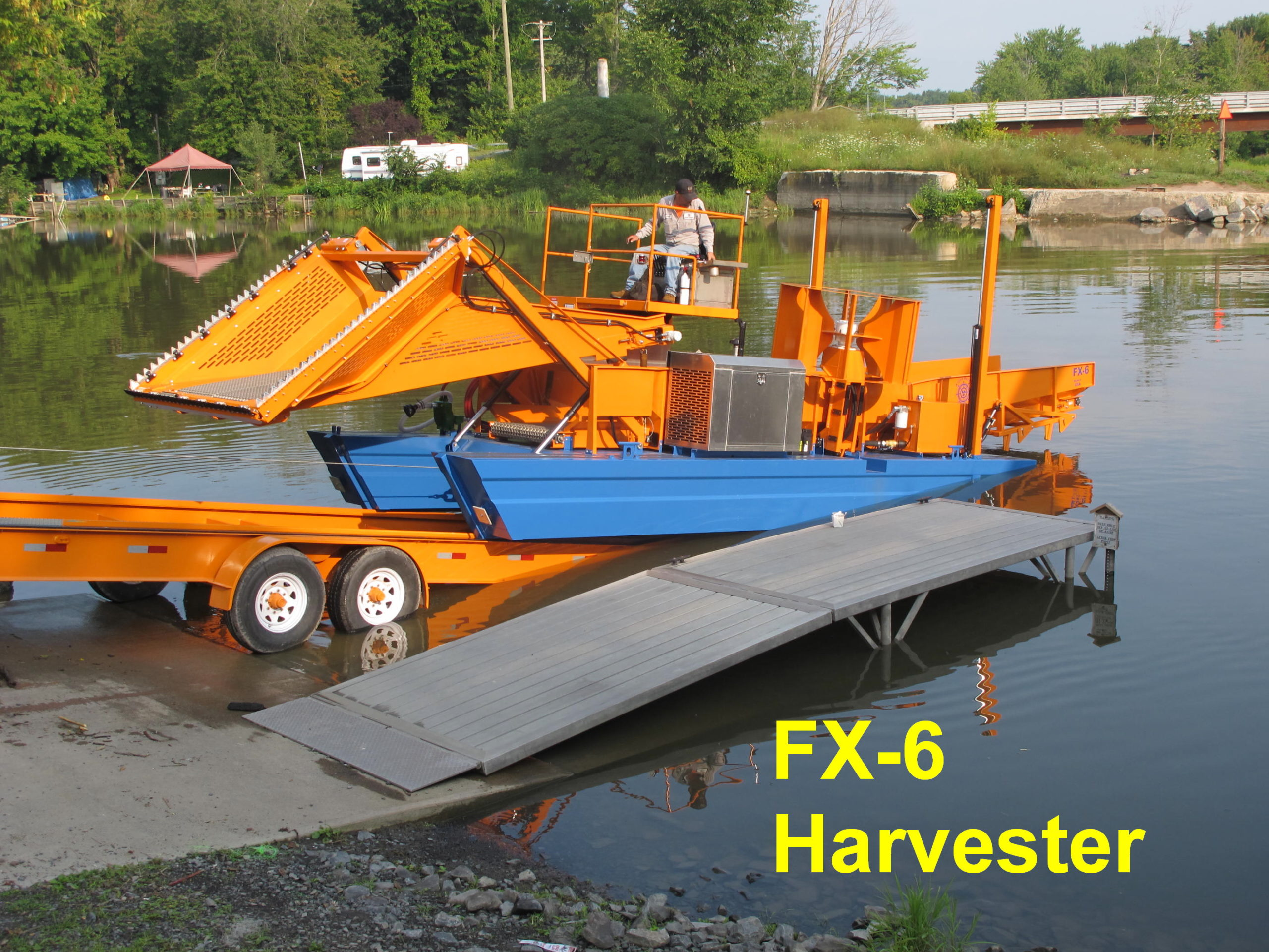 Alphaboats FX6 Waterweed Harvester Launching from Alphaboats Transport Trailer