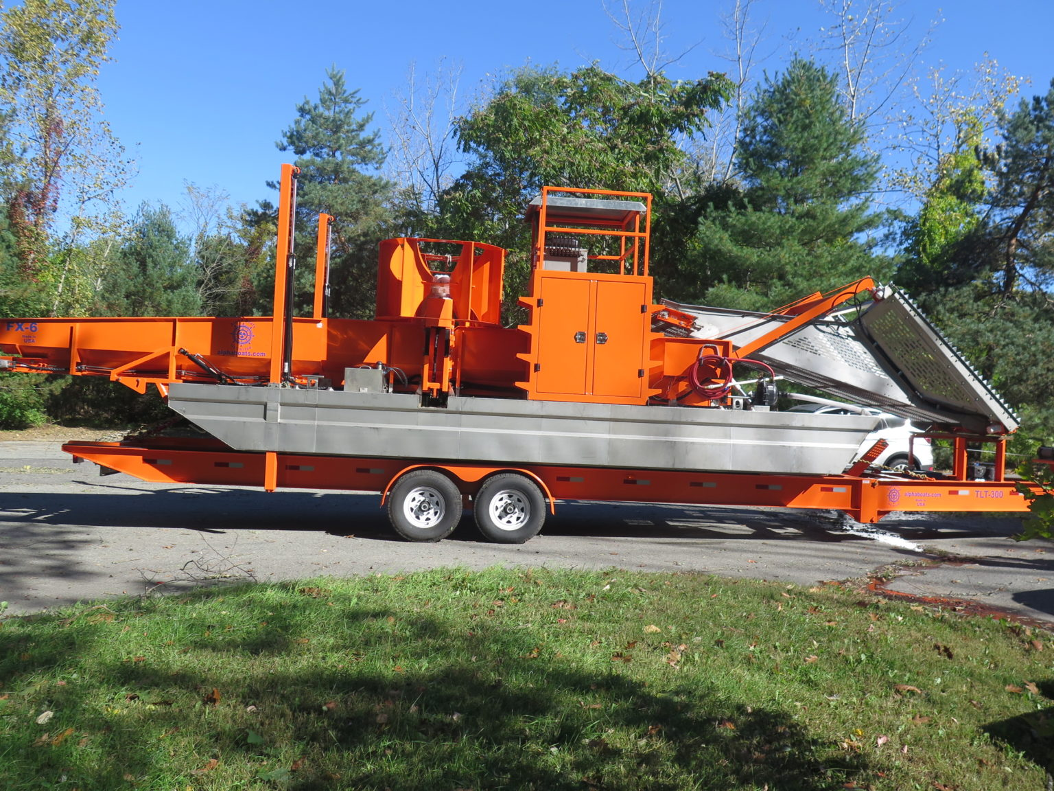 Alphaboats FX6 Waterweed Harvester on Alphaboats Transport Trailer