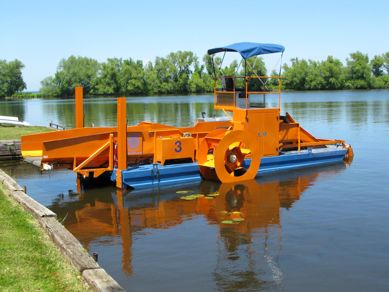 Alphaboats FX7 Waterweed Harvester with Spuds Anchored