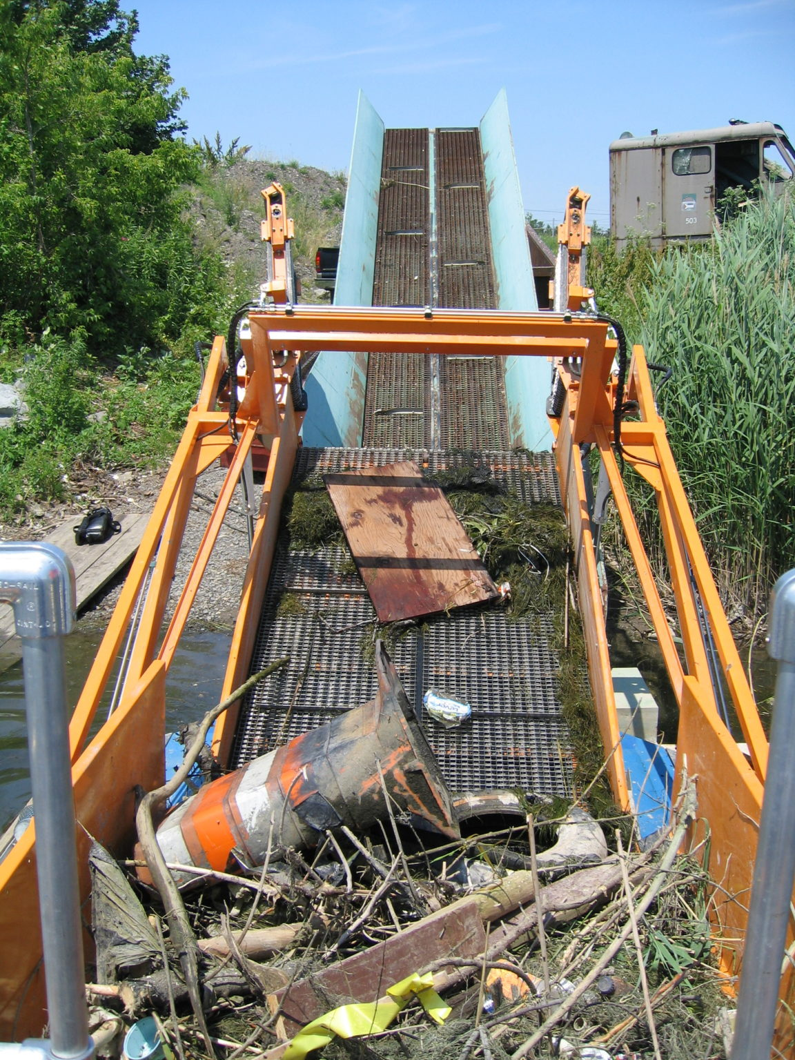 MC 202 off loading debris with a conveyor