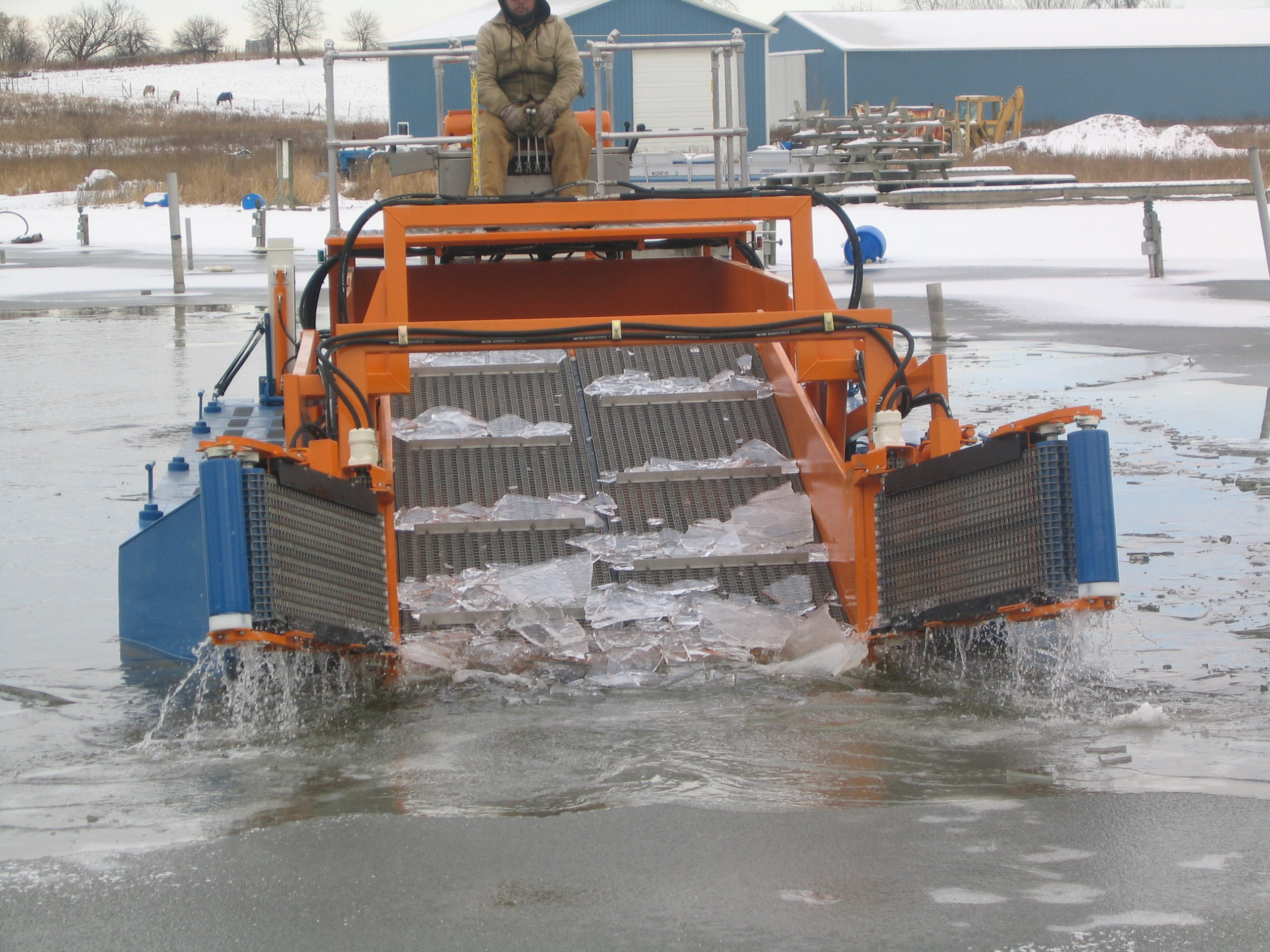 MC 202 picking up winter ice from a marina