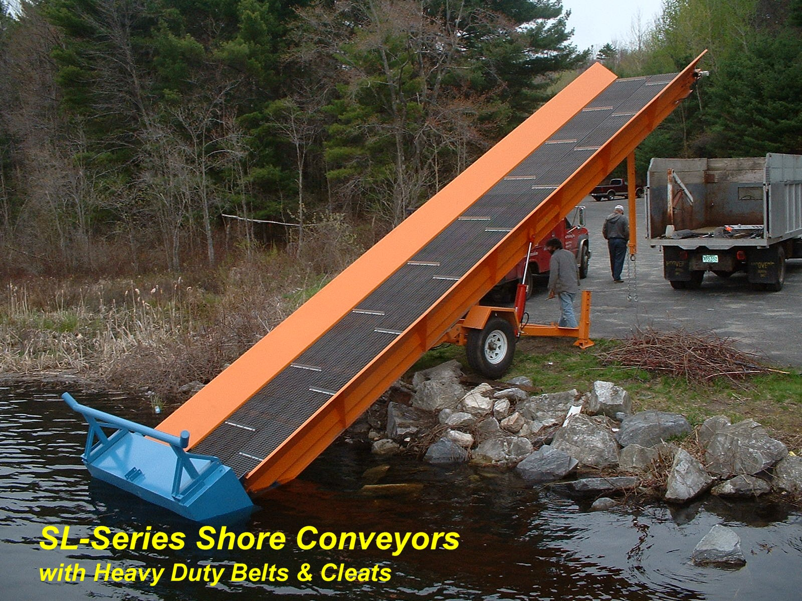 Alphaboats Shore Conveyor ready to load aquatic weeds from harvester