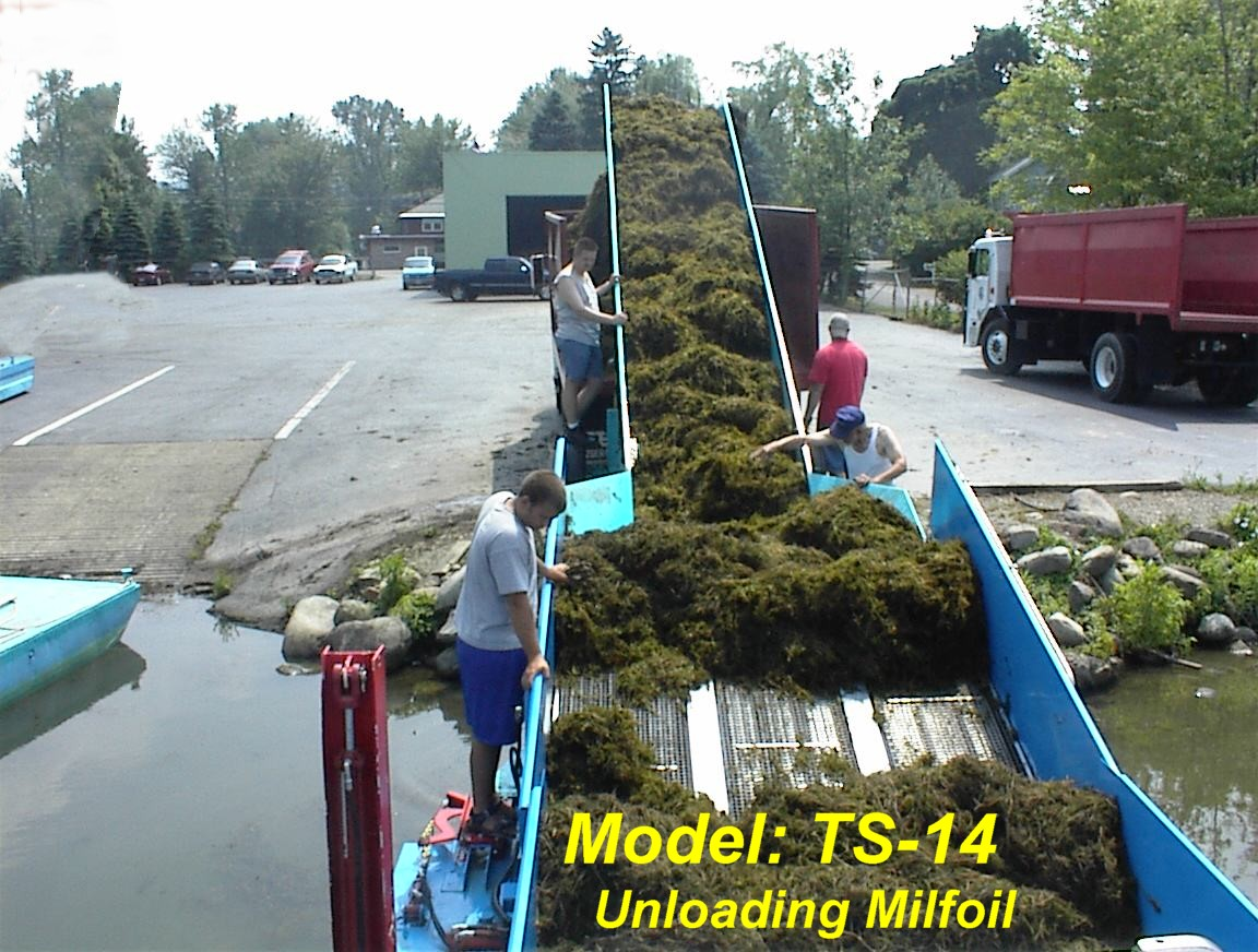 Alphaboats TS18 Transport Barge unloading milfoil aquatic weeds