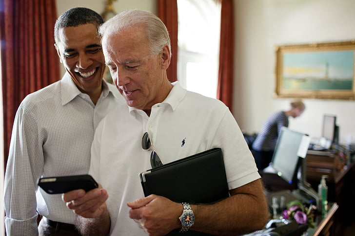 Barack Obama And Joe Biden Looking At Iphone Smiling