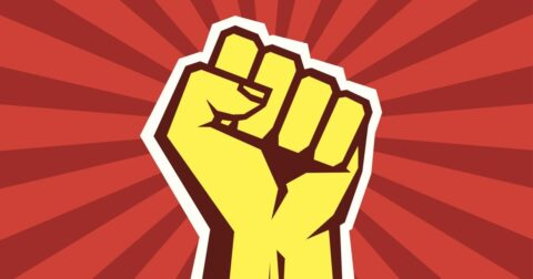 Yellow Fist On Red Background